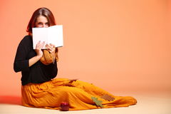 Autumn fashion girl with book orange eye-lashes Royalty Free Stock Photo