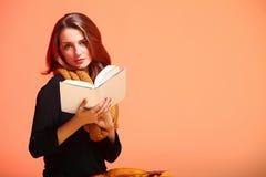 Autumn fashion girl with book orange eye-lashes Stock Photos