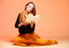 Autumn fashion girl with book orange eyelashes Royalty Free Stock Photography
