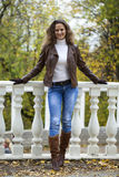 Autumn fashion image of young woman walking in the park Stock Photography