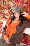 Autumn fashion portrait young woman relax bench Royalty Free Stock Photography