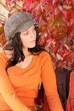 Autumn fashion portrait young woman relax bench. Autumn leaves fashion portrait young woman relax looking aside stock photography