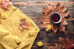 Autumn fashion seasonal concept sweater cardigan cup hot black tea. Autumn fashion seasonal concept, yellow warm soft comfortable sweater cardigan cup hot black stock photos