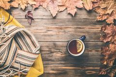 Autumn fashion seasonal concept sweater cardigan Scandinavian knitted scarf cup hot black tea. Autumn fashion seasonal concept yellow warm soft sweater cardigan stock images
