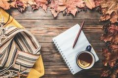 Autumn fashion seasonal concept sweater cardigan Scandinavian knitted scarf cup hot black tea. Autumn fashion seasonal concept yellow warm soft sweater royalty free stock photos