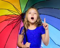 Autumn fashion. Stay positive though autumn rain season. Bright accessory for autumn. Ideas how survive cloudy autumn. Day. Small girl with umbrella rainy day stock photography