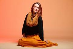 Autumn fashion woman fresh girl eye-lashes. Fall. Fashion woman in autumn color fresh girl in full length long false orange eye-lashes Stock Photo