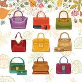 Autumn fashion. Women's handbags and leaves top Stock Photos
