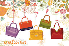 Autumn fashion. Women's handbags and leaves Royalty Free Stock Photos