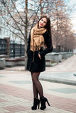 Autumn fashionable portrait of young happy brunette girl red lipstick outdoors in the city Royalty Free Stock Photos