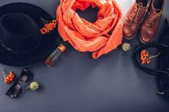 Autumn female outfit. Set of clothes, shoes and accessories. On grey background stock photography