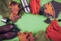 Autumn female outfit. Set of clothes, shoes and accessories. On brown background Royalty Free Stock Photo