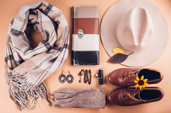 Autumn female outfit. Set of clothes, shoes and accessories. On brown background Royalty Free Stock Image