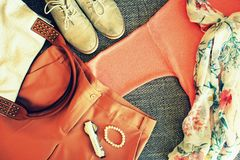 Autumn female outfit. Set of clothes, shoes and accessories on grey background.  royalty free stock photos