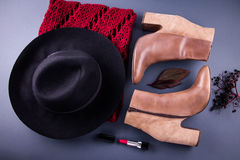 Autumn female outfit. Set of clothes, shoes and accessories. On grey background Royalty Free Stock Photography