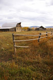 Autumn, fence and old western farm buildings Royalty Free Stock Image