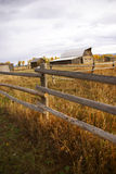 Autumn, fence and old western farm buildings Stock Images