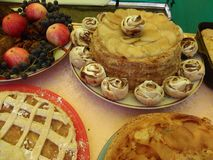 Homemade cakes with apples and a bowl of fruit and berries. royalty free stock photos