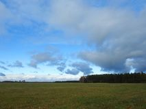 Field and beautiful cloudy sky Royalty Free Stock Images