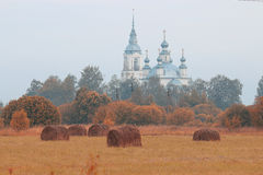 Autumn field and church on horizon Royalty Free Stock Photography