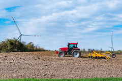 Autumn field works close to the windmills Stock Photos
