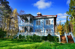 Autumn, fine old wooden house Stock Photos
