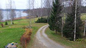 Autumn in Finland. The road leading from the cottage to the woods and the lake.Autumn in Finland stock images