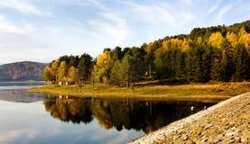 Autumn fishing. Bulgarian autumn lake and fisherman Royalty Free Stock Photo