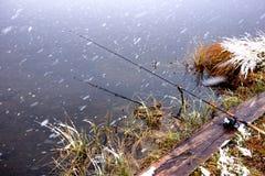 Autumn fishing under snowfall Royalty Free Stock Photos