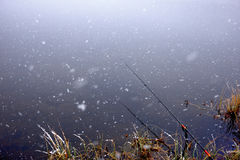 Autumn fishing under snowfall Royalty Free Stock Photo