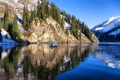 Autumn fishing under snowfall Royalty Free Stock Photography