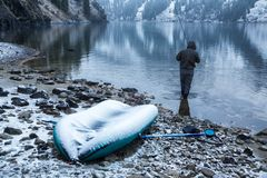 Autumn fishing under snowfall Royalty Free Stock Photos