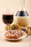 Autumn flavours. Chestnuts, marron glace and young wine. Light brown background Stock Photography