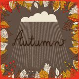Autumn floral background with leaves, text autumn and cloud with rain. Bright floral background in vintage style. Brawn backdrop. Royalty Free Stock Image