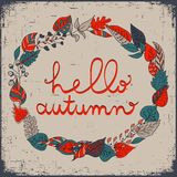 Autumn floral frame with leaves and text hello autumn. Bright floral background in vintage style. Stock Photos