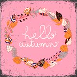 Autumn floral frame with leaves and text hello autumn. Bright floral background in vintage style. Yellow background. Stock Photos