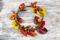 Autumn floral wreath on rustic wooden background Stock Photo