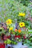 Autumn flower arrangement on garden table Royalty Free Stock Photography