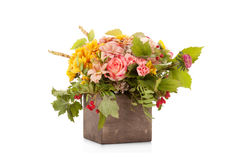 Autumn flower bouquet with berries and apple in wooden box Stock Image