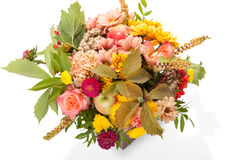 Autumn flower bouquet with berries and apple in wooden box Stock Photos