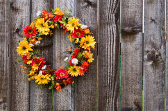 Autumn flower wreath. On rustic wooden fence stock images
