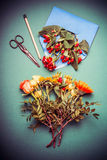 Autumn  flowers arrangements making on table workspace with scissors , envelope and ribbon. Top view Stock Photo