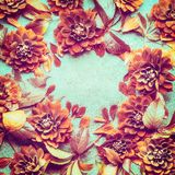 Autumn flowers background with leaves and dahlias, top view, frame. Fall layout. For your design stock photo