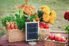 Autumn flowers in a basket, apples and pears Stock Photo