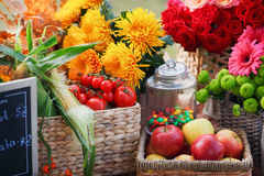 Autumn flowers in a basket, apples and pears Stock Image