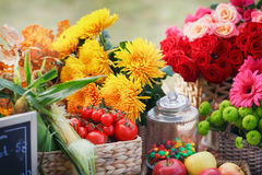 Autumn flowers in a basket, apples and pears Stock Photos