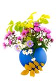 Autumn flowers in blue vase. Bouquet of autumn colors in blue ceramic beautiful vase with yellow leaves on white background Royalty Free Stock Photos