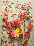 Autumn flowers and leaves flat lay composing, top view. Fall floral still life with chrysanthemums. And red orange branches royalty free stock photos