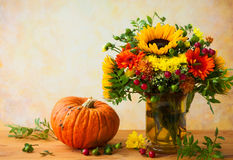 Autumn flowers and pumpkin Royalty Free Stock Photo