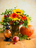 Autumn flowers and pumpkin Stock Photography